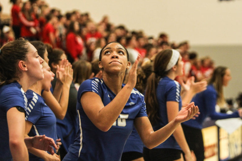 Eyes on the clock, senior Bria King checks the remaining time against Fishers Sept. 7. From a young age King was inspired by her cousins to play volleyball.