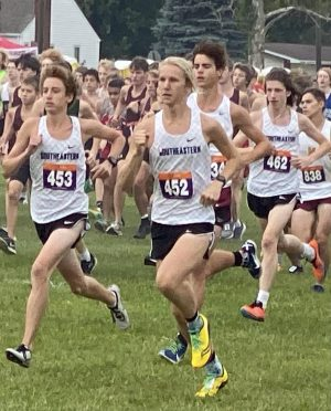 Eyes ahead, senior Luke Andritsch races against other students during a Cross Country meet.